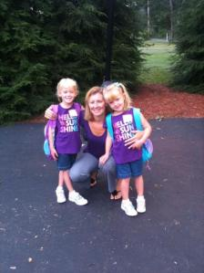 Mrs. Bell with her twin daughters, Lexi and Audrey