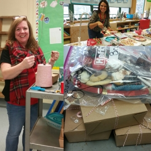 "Paton PTO President Melissa Wensky and a parent volunteer package up ""to go"" treat plates for bus drivers and other staff who need their treats on the run!"